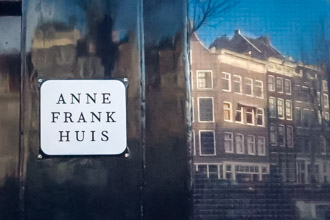 Anne Frank House with the reflection in the window of the houses across the street