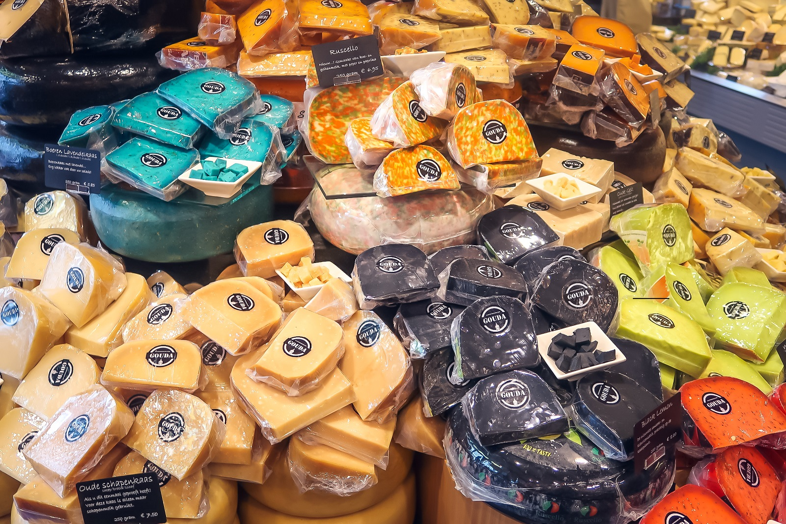 Explore the delightful and colourful offering of cheese on display at Kaaswinkeltje Cheese Shop