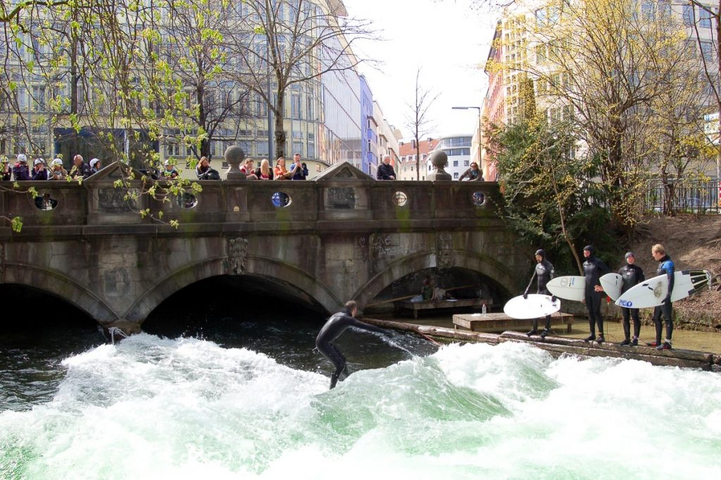 Surfing The Eisbach in Munichs English Garden